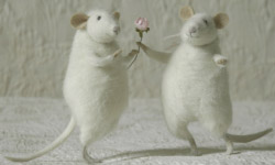 Image of a Mouse giving another Mouse a Flower